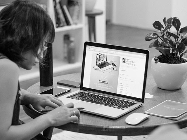 Woman working on a website blog